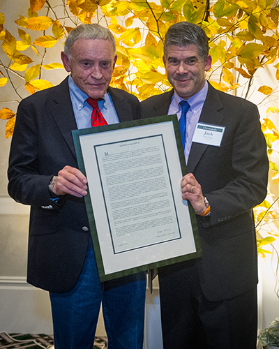 Kelton receiving award