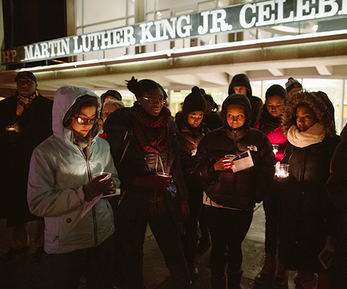 Students attending a MLK Jr. candlelight vigil