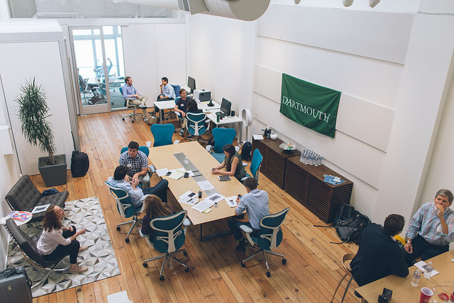 Alumni mingling around a table at Dartmouth Entrepreneurs Forum