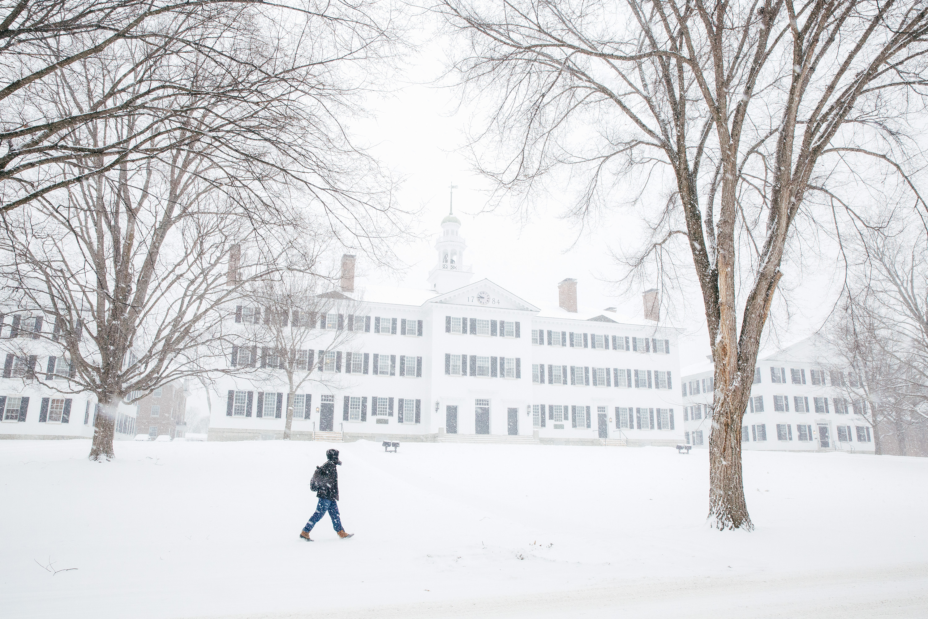 Student walks across the Green in the snow