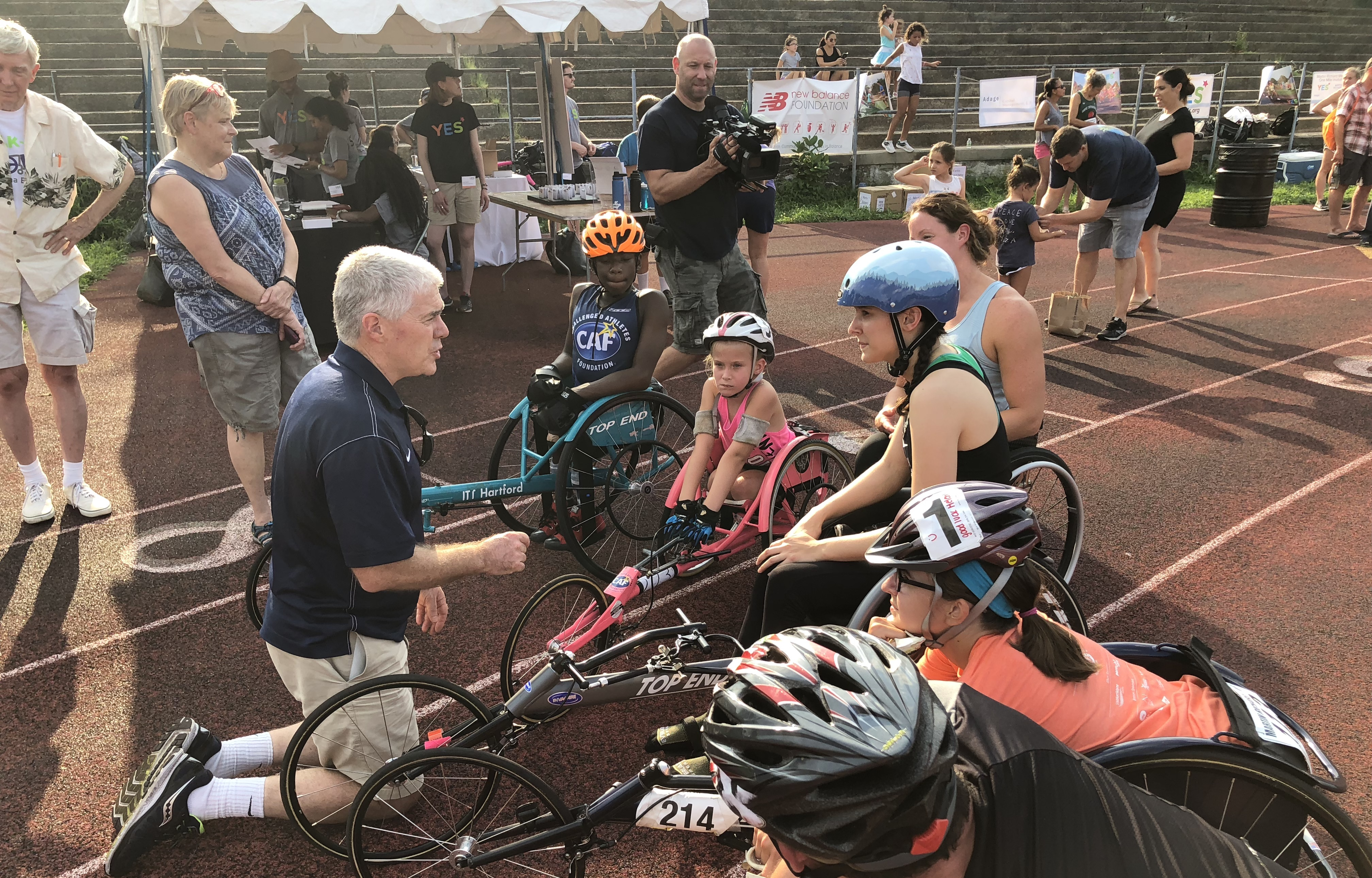 Joe Walsh speaks to young athletes before a race.