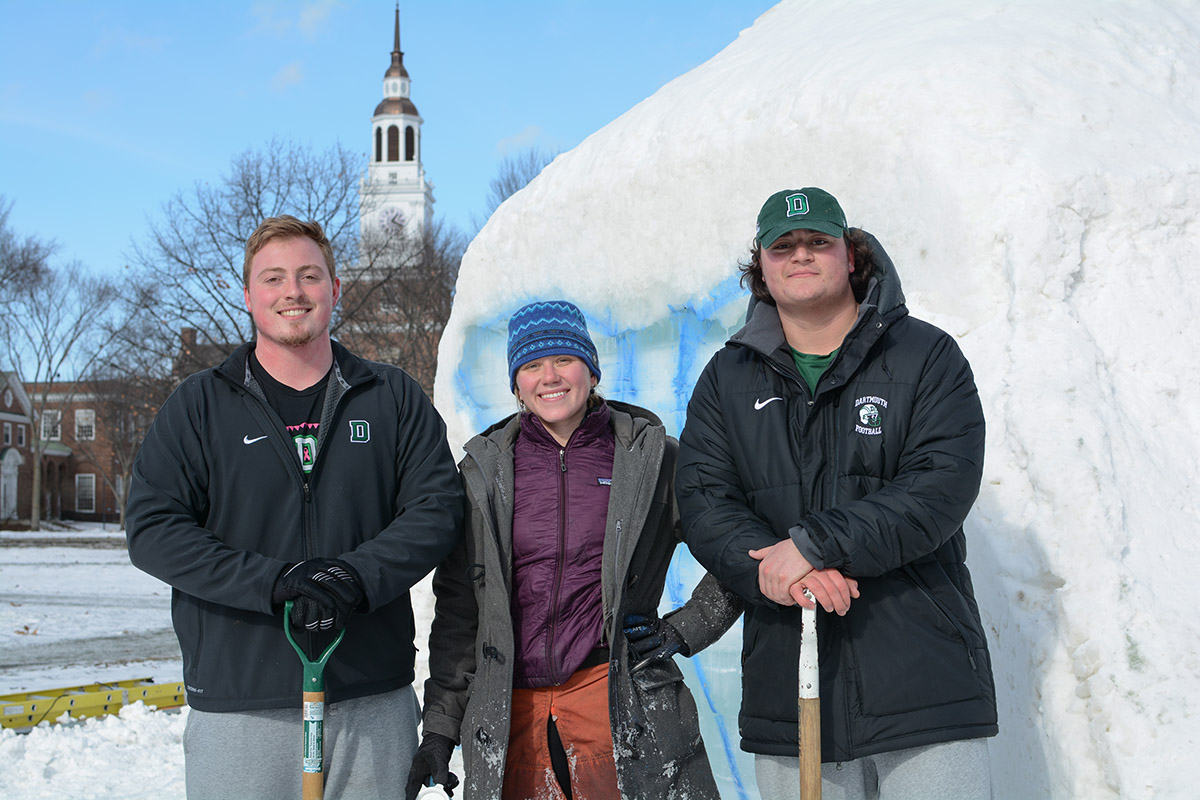 Students work on the Winter Carnival Snow Sculpture