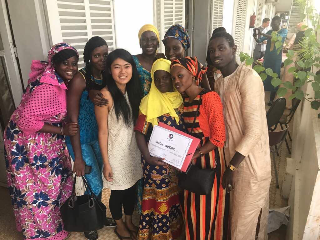Yi Yang '14 with community members in Senegal.
