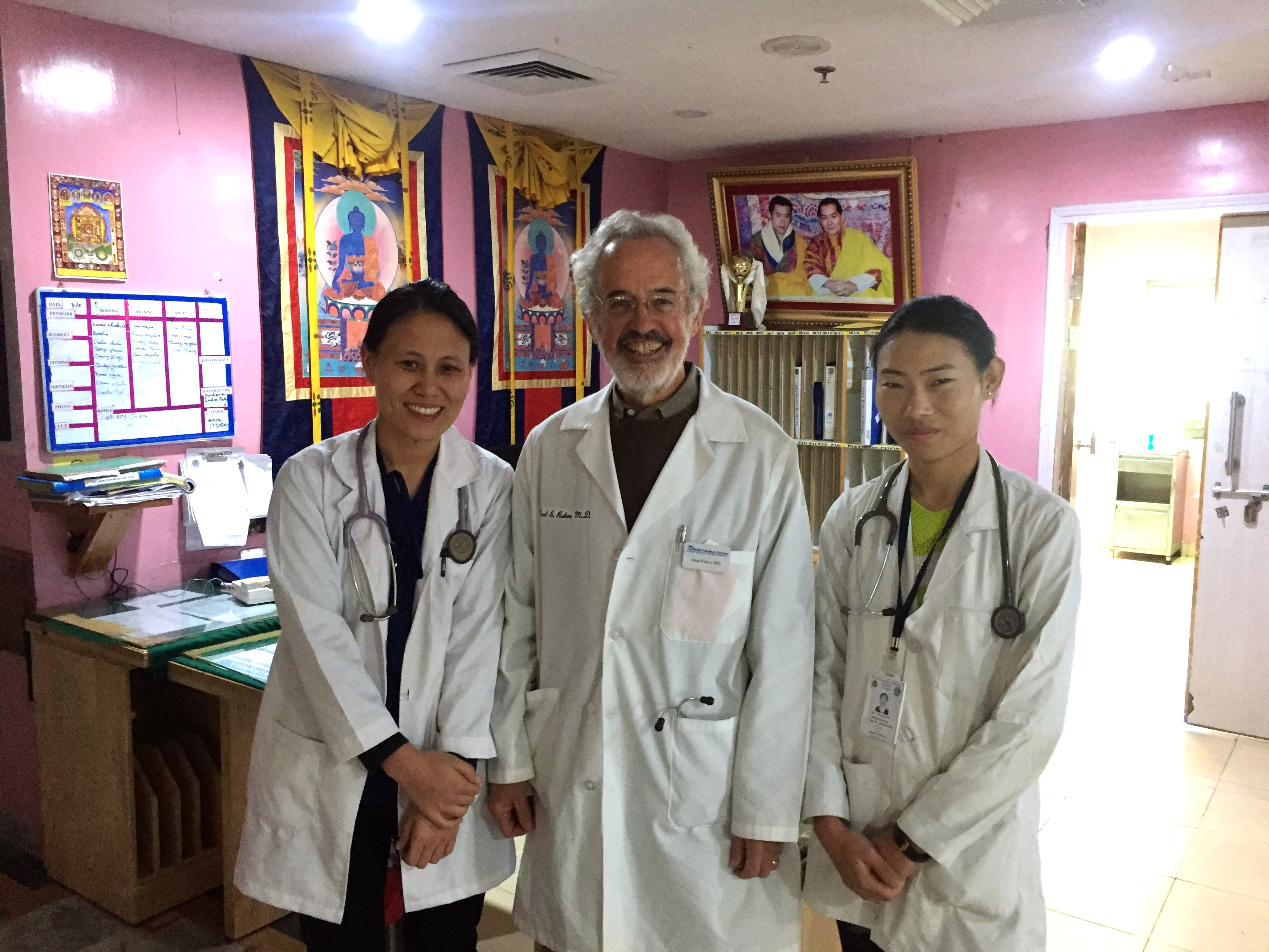 Neal Rakov '74 does the rounds with a resident and a first-year med student in Bhutan.