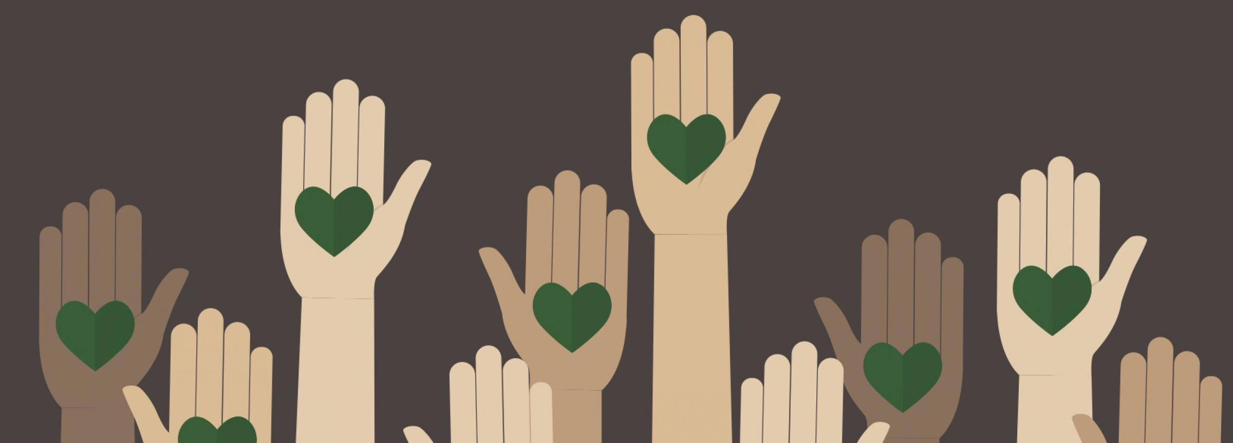 Hands holding green hearts