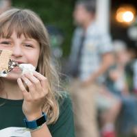 Child eating s'mores during Camp Dartmouth