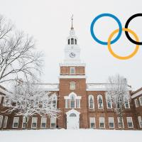 Olympic ring logo overlay on snowy image of Baker Tower