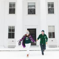 Kate Lyon and Chris Bustard running in front of Dartmouth Hall