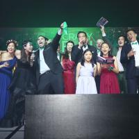 Dartmouth alumni singing on stage at the Ivy Ball in Hong Kong