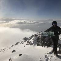 Lisa Caldeira atop Mt. Kilimanjaro
