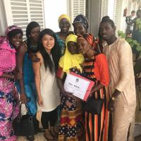 Yi Yang '14 with community members in Senegal.